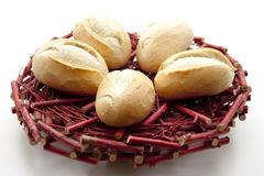 Bread rolls on red wooden plate Stock Photo