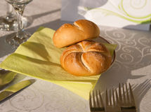 Bread rolls on a restaurant table Royalty Free Stock Photos