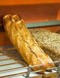Bread and rolls on a shop show-window Royalty Free Stock Photography