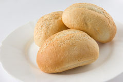Bread Rolls on white plate Stock Photo