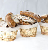 Bread and rolls in wicker basket Royalty Free Stock Photo