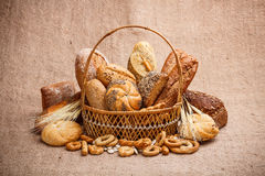 Bread and rolls in wicker basket Royalty Free Stock Images