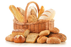 Bread and rolls in wicker basket  on white. Composition with bread and rolls in wicker basket  on white background Stock Photos