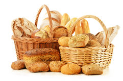 Bread and rolls in wicker basket on white Royalty Free Stock Photos