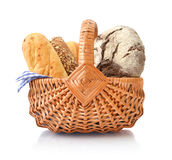 Bread and rolls in wicker basket Royalty Free Stock Image