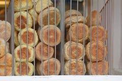 Bread rolls in window of bakery Stock Photos