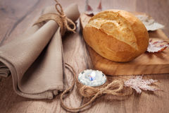 Bread rolls on wooden plate with winter decorations Royalty Free Stock Photo