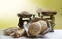 Bread. Rural still life. Bread in basket and vintage weight scale. Rural still life Stock Images
