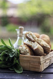 Bread Rustic Homemade Mediterranean. Homemade rustic bread in basket with sage on side an olive oil bottle in the background Royalty Free Stock Photos