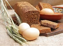 Bread rye cut with slices and eggs Royalty Free Stock Images