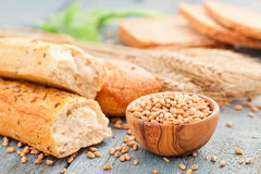 Bread and rye grain. On a wooden table Stock Photography
