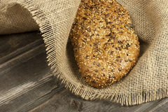 Bread rye on a old wooden table royalty free stock photo