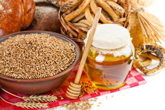 Bread rye spikelets. Rye bread on wooden table on wooden background royalty free stock image