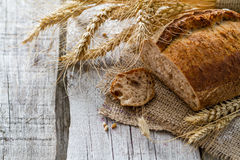 Bread, rye, wheat, rustic wood background Stock Image