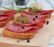 Bread and salami Stock Image