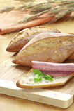 Bread with salami and basil Stock Images