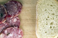 Bread with salami. Bio food snack royalty free stock photo