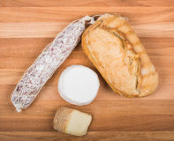 Bread, salami and  cheeses Royalty Free Stock Photography