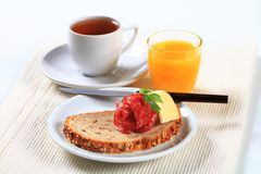 Bread with salami, cup of tea and orange juice Stock Photography