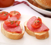Bread with salami Stock Photos