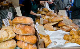 Bread sale. Freshly baked loaves of bread on a market stall royalty free stock photo