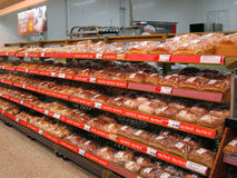 Bread for sale on a store shelves. Fresh bread for sale on the shelves of superstore. This display is in the Morrison's supermarket in Northampton, England Stock Photography