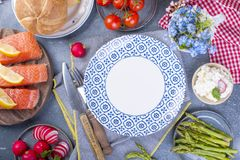 Bread and salmon fillets, asparagus and cheese. A plain plate. Different Healthy Eating. Delicious breakfast for the family. Food royalty free stock image