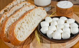 Bread, salt and cheese. Slices of bread with mozzarella and salt Stock Photography