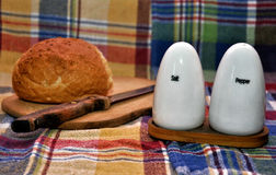 Bread with salt and pepper shakers Royalty Free Stock Photography