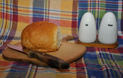 Bread with salt and pepper shakers Stock Image