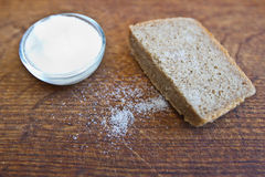 Bread and salt on the wooden table. Bread and salt on the wooden background Stock Photo