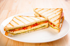 Bread sandwich with cheese, tomato. Healthy vegetarian snacks. Royalty Free Stock Image