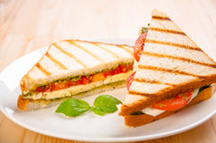 Bread sandwich with cheese, tomato. Healthy vegetarian snacks. Royalty Free Stock Images