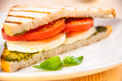 Bread sandwich with cheese, tomato. Healthy vegetarian snacks. Stock Photo