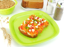 Bread Sandwich. Whole-wheat bread open sandwich, with toppings of cottage cheese, cucumber slices, tomato pieces and carrot gratings Stock Photos