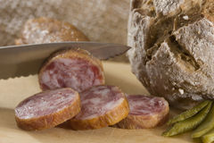 Bread and sausage. On plate Stock Photo