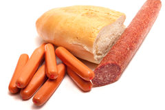 Bread and sausage. Fresh bread and sausage on a white background Royalty Free Stock Photos