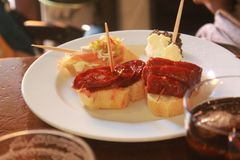 Bread, sausage and cheese tapas royalty free stock images