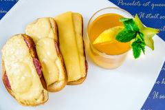 Bread with sausage and cheese and tea royalty free stock photos