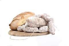 Bread and sausage on cutting board Stock Photo