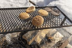 Bread and sausage on the grill above the wooden fire. Picture from the Northern Sweden Royalty Free Stock Photography