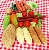 Bread sausage and vegetables Royalty Free Stock Photos