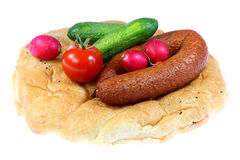 Bread, sausage and vegetables. Stock Image