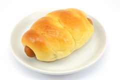 The Bread with Sausage on white plate Royalty Free Stock Photos