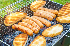 Bread sausages barbeque grill . Royalty Free Stock Image