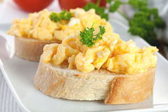 Bread with scrambled eggs Royalty Free Stock Photos