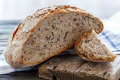 Bread with seeds of flax, sunflower, sesame and pumpkin. Stock Photo