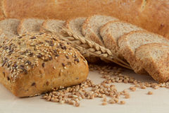Bread with seeds and slices of dark bread Royalty Free Stock Photography