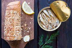Bread with seeds and sprat in the bank Stock Image