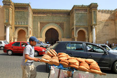 Bread seller and Bab el-Mansour gate Royalty Free Stock Photo